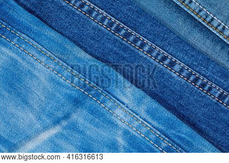 Photo Of Denim Pants From Above. Background On The Theme Of Denim Clothing.