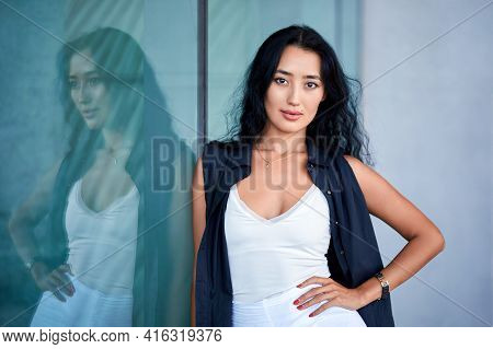 Fashion Close-up Portrait Of Young Woman Posing  Near To Showcase