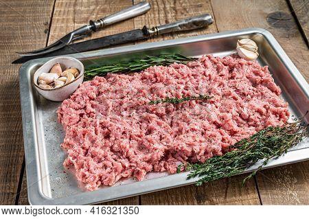 Raw Chicken Or Turkey Ground Meat In A Kitchen Tray. Wooden Background. Top View