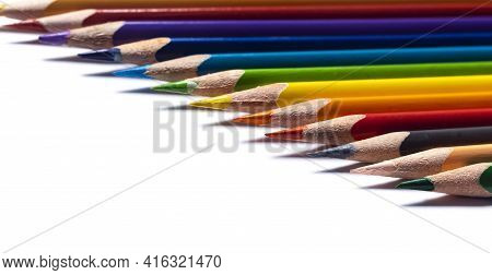 Close Up View Of Color Wooden Pencils With Shallow Depth Of Field On White Background