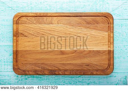 Multifunctional Wooden Chopping Board For Cutting Bread, Pizza Or Steak On Wood Background. Soace Fo