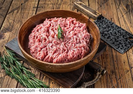 Chicken Or Turkey Mince Meat, Raw Poultry In A Wooden Plate. Wooden Background. Top View