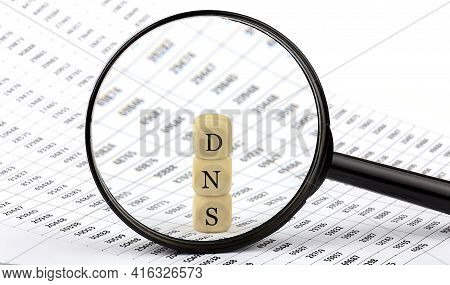 Dns Wooden Cubes On Chart Background , Look Through Magnifier