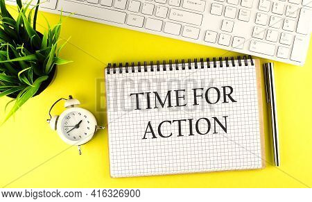 Time For Action Text On Notebook With Keyboard , Pen And Alarm Clock On Yellow Background