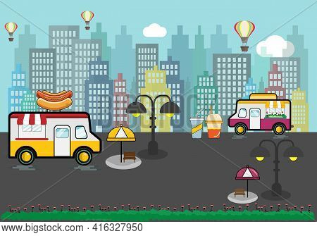 Food Trucks With Wooden Bench, Umbrella. Urban Landscape, Buildings And Hot Air Ballon Background. R