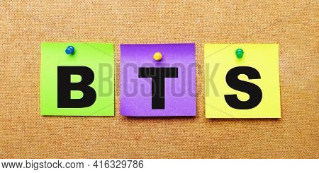 On A Beige Background, Multi-colored Stickers For Notes With The Word Bts