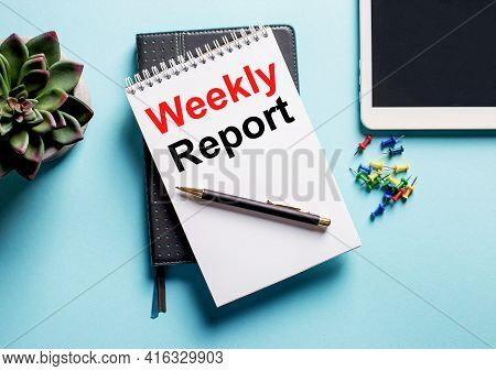 On A Light Blue Background, There Is A Potted Plant, A Tablet And A Weekly With The Text Weekly Repo