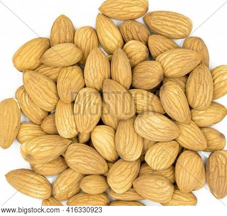 Raw Almond Closeup On White Background. Natural Organic Nut Kernel. Protein Superfood Or Healthy Sna