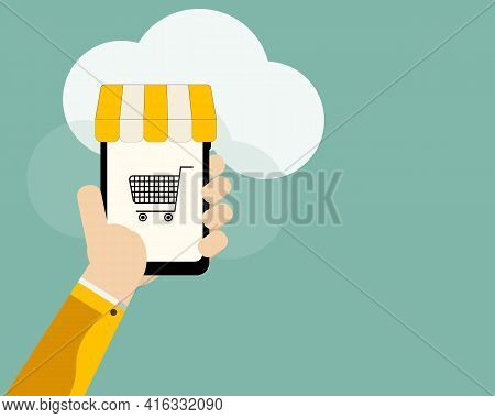 Shopping Online,ecommerce Concept.mobile Phone Or Smartphone In Hand With  Yellow Awning And Shoppin