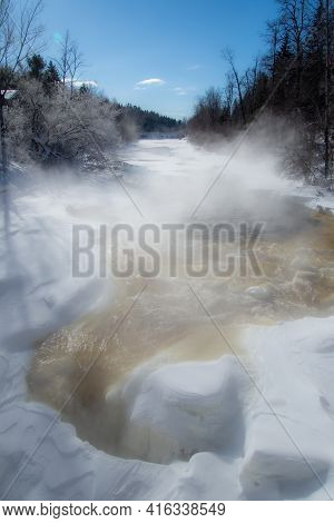 Icy River In The Canadian Winter In Quebec