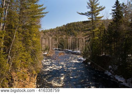 Icy River In The Canadian Spring In Quebec