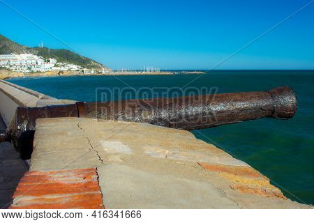 Old Cannon On The Rampart By The Sea In Sitges, Spain