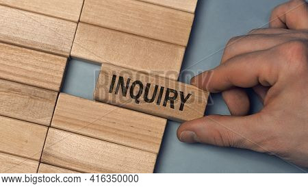 Inquiry Word Concept. Close-up Wooden Piece Blocks On The Table. Top View
