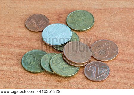 Coins Of The Belarusian Ruble on Wooden Table.