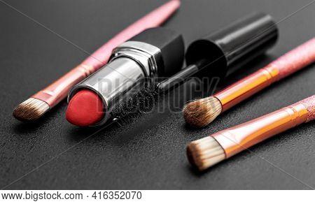 Makeup Brushes With Lipstick And Mascara Brush On Black.