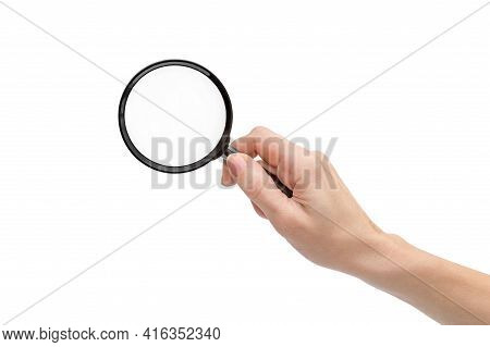 Woman's Hand Holding Magnifying Glass. Isolated On White.