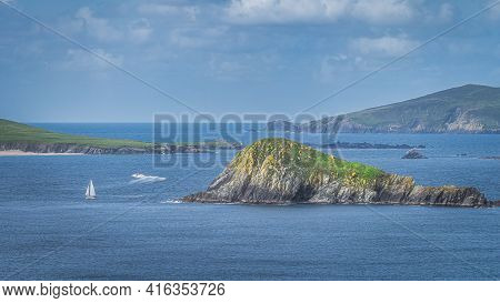 Sailboat And Motorboat Sailing Between Small Rocky Islands In Dingle Peninsula, Seen From Slea Head,