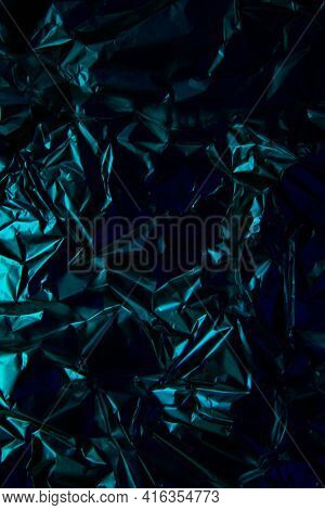 Foil Background. Crumpled Foil. Abstract Background. Wallpaper. Blue And Black