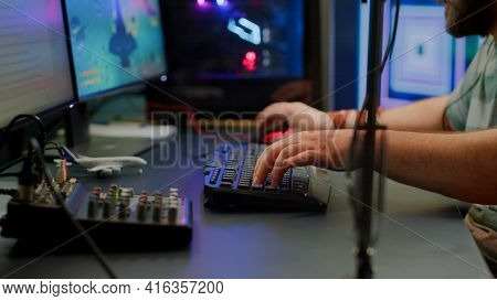 Close Up Of Streamer Typing At Rgb Keyboard Playing Space Shooter Videogame