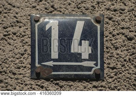 Weathered Grunge Square Metal Enamelled Plate Of Number Of Street Address With Number 14