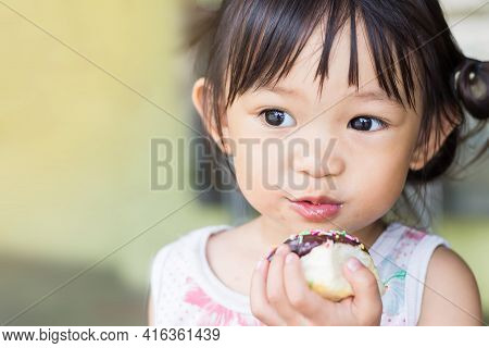 Selective Focus. Portrait Image Of 2-3 Years Old Of Baby. Happy Asian Child Girl Eatin