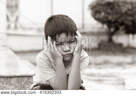Sepia Tone. 5-6 Years Old Child. Alone Asian Little Boy Feel Sad, Headache And Stressed.