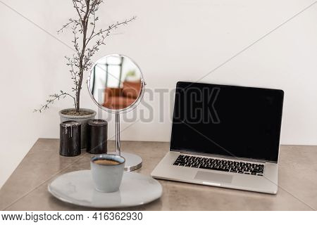 Close Up Laptop Computer On Top Of Office Table Of A Businessman With Empty White Screen, Emphasizin