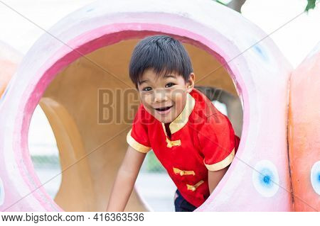 Portrait Of Happy Asian Child Boy Smiling And Laughing, He Playing With The Toy At The