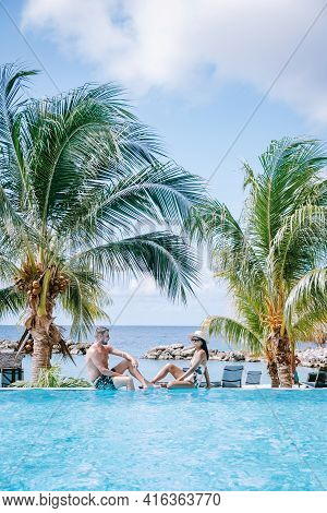 Curacao Willemstad, Couple Mid Age Asian Woman And European Man On Vacation At A Luxury Resort In Pi
