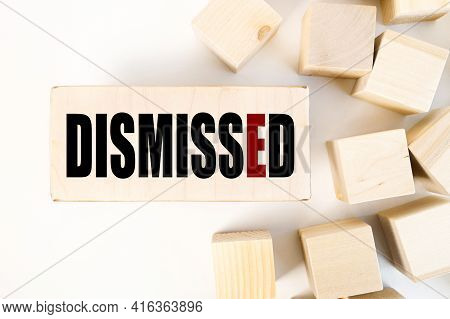 Dismissed. Text On A Piece Of Wood. On A White Background