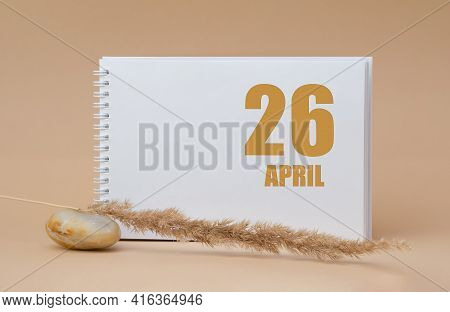 April 26. 26th Day Of The Month, Calendar Date.white Blank Sheet Of Notepad, Stones, Dry Sprig Of Gr