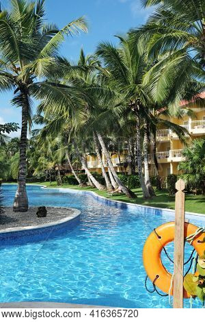PUNTA CANA, DOMINICAN REPUBLIC - DEC 21, 2016:Pool area at Dreams Resort and Spa, Punta Cana in the Dominican Republic. The resort is one of several properties in the AMResorts Collection.