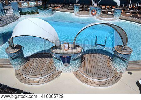 SAN JUAN, PUERTO RICO - 20 MAR 2012: Pool Deck on the MSC Poesia Luxury LinerPool Deck on the MSC Poesia Luxury Liner
