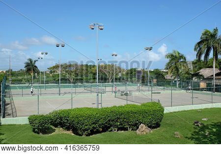 PUNTA CANA, DOMINICAN REPUBLIC - DEC 21, 2016:Tennis Courts at Dreams Punta Cana in the Dominican Republic. The resort is one of several properties in the AMResorts Collection.
