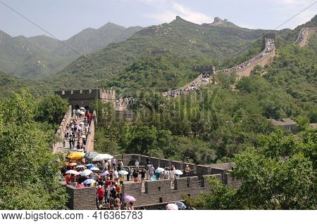 BADALING, CHINA - JULY 2006: Tourists line the Great Wall at Badaling, China. About 10 million people trek to the historic Great Wall every year making it China's most popular tourist destination.