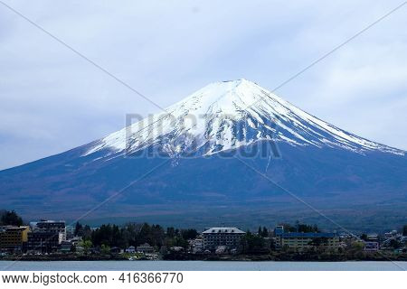 Close Up Fuji Mountain In Herizontal,against Blue Clods Sky Background ,cityscape View In Front With