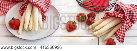 Fresh White Asparagus And Strawberries On White Vintage Table. Horizontal Food Photography For Seaso