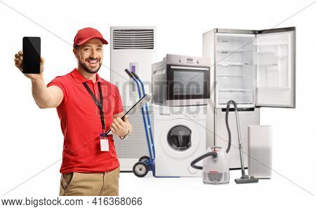 Male shop assistant with electircal home appliances showing a mobile phone isolated on white background