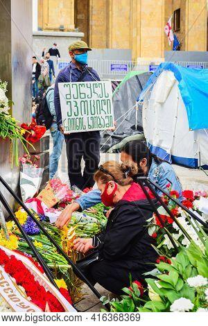 Tbilisi, Georgia - 9th April, 2021: Person Express Solidarity In Anniversary Event.