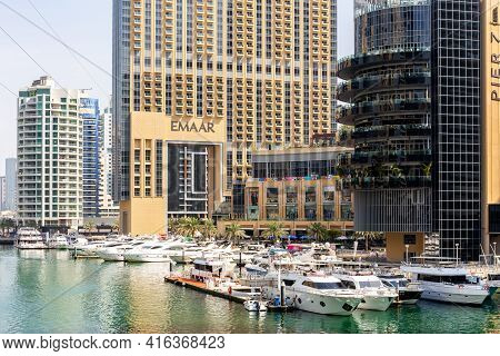 Dubai, Uae, 22.02.2021. Dubai Marina Mall Marine Transport Station On Marina Canal, With Address Dub