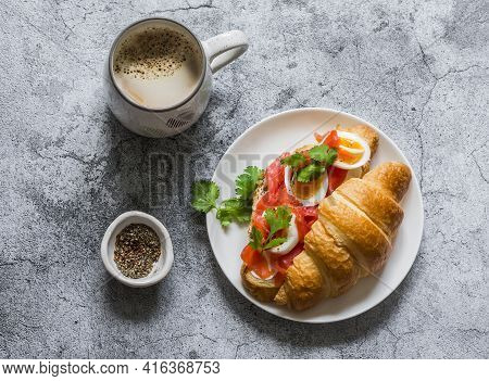 Delicious Brunch - Coffee With Cream And Croissant Sandwich With Cream Cheese, Salmon And Boiled Egg
