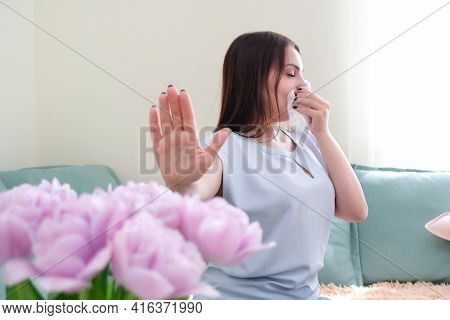 Young Woman Sneezes From Flower Allergy. Pollen Allergy