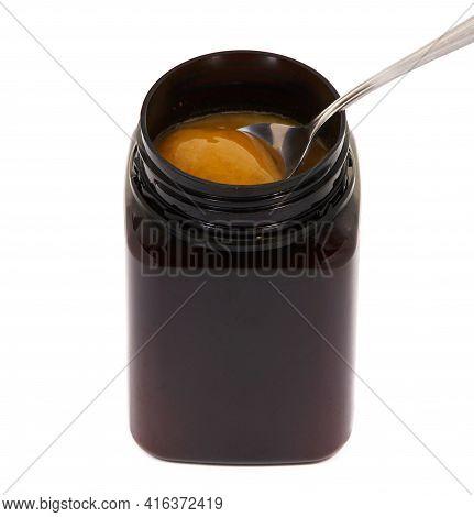 Jar Of Manuka Honey With Spoon Isolated On White