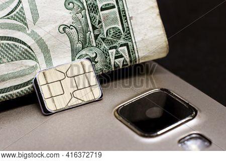Sim Card For Cellular Phones On Dollar Bill, Macro