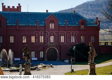 Red Neo-gothic Castle On Bank Of Eger River Ohre, Historic Romantic Chateau With English Park And Ga