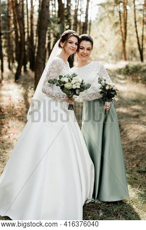 Tender Bride With Smiling Bridesmaids Dressed In Long Elegant Dresses,bridesmaids With Happy Bride O