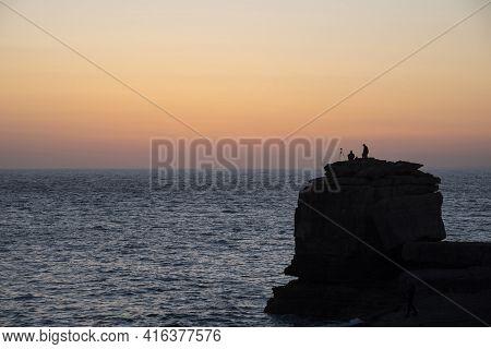 Beautiful Silhouette Landscape Image Of Pulpit Rock In Portland Weymouth Dorset Against Vivd Peacefu