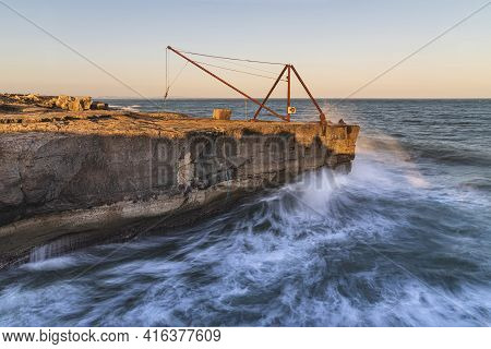 Beautiful Sunset Landscape Image Of Portland In Weymouth, Dorset With Long Exposure Wave Formations