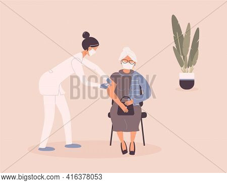 Coronavirus Vaccination Of Patient By Doctor.older Woman In Protective Medical Mask Get Virus Grafti