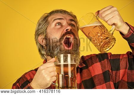 Enjoy Your Beer. Sport Bar. Trying A New Beer. Brutal Hipster Drink Beer. Mature Bearded Man Hold Be